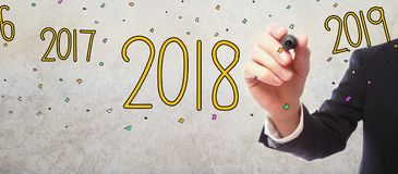 2018 with businessman. On gray wall background Royalty Free Stock Photography