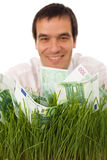 Businessman with green banknotes in grass Stock Photos