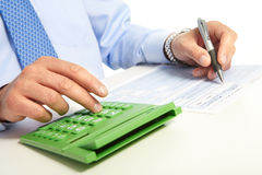 The businessman and green calculator Royalty Free Stock Image