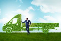 The businessman with green ecological vehicle. Businessman with green ecological vehicle stock images