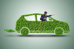 The businessman in green electric car concept Stock Photo