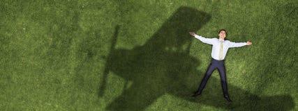 Businessman on green grass Stock Photos
