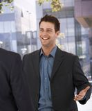 Businessman greeting colleague at office Royalty Free Stock Photography
