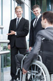 Businessman greeting the disabled man Stock Photography