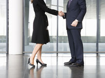A businessman greeting a female client Stock Photography