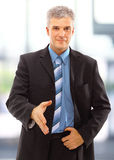 Businessman greeting with handshake Stock Photography