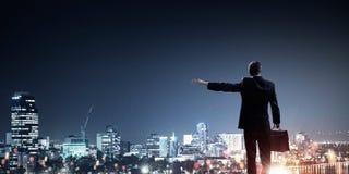Businessman greeting his city Stock Photos