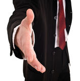Businessman with greeting outstretched  hand. Royalty Free Stock Images