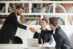 Businessman greeting welcoming new partner or making deal with h. Businessman greeting congratulating new smiling executive team member or making deal with Stock Images