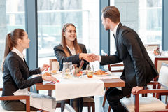 Businessman greets the partners Royalty Free Stock Image