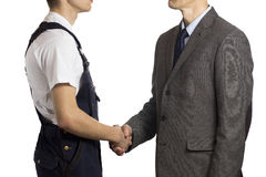Businessman greets a worker Stock Photos