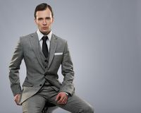 Businessman  on grey Stock Photography