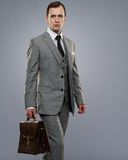 Businessman  on grey Royalty Free Stock Images