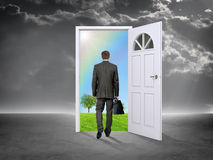 Businessman in grey room with door in nature Stock Images