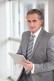 Businessman with grey suit Stock Photography