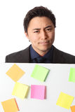 Businessman in grey suit with board full of notes Royalty Free Stock Photography