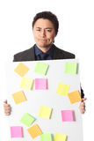 Businessman in grey suit with board full of notes Stock Photo