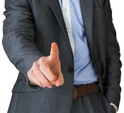 Businessman in grey suit pointing Royalty Free Stock Image