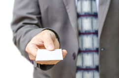 Businessman in grey suit  shows business card with copy space Royalty Free Stock Images