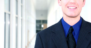 Businessman grins Royalty Free Stock Image