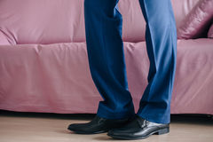 Businessman or groom wears shoes. Businessman or groom wears black shoes blue plants Royalty Free Stock Image