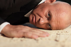 Businessman on the ground Royalty Free Stock Photo