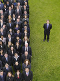 Businessman By Group Of Executives In Row Royalty Free Stock Photography