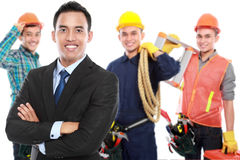Businessman with group of professional male engineer at the back Royalty Free Stock Photography