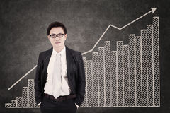 Businessman and growing bar chart Stock Images