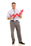 Businessman with growth arrow. Cheerful middle aged businessman with growth arrow Royalty Free Stock Images