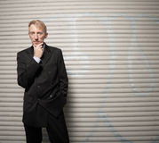 Businessman on a grungy background Stock Image