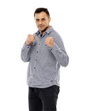 Businessman in guard stance. Strong businessman in guard stance with fists up, ready to fight Stock Images