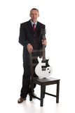 Businessman with guitar Stock Image