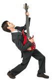 Businessman guitarist in suit poses. On white royalty free stock photos