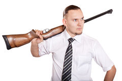 Businessman with gun. Handsome Serious Businessman with gun at white background royalty free stock photos
