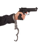 Businessman with gun and handcuffs Stock Image