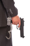 Businessman with gun and handcuffs Stock Photography