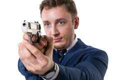 Businessman with gun. Isolated white background Stock Photography