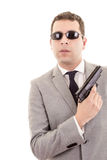 Businessman with gun isolated on white Stock Photo