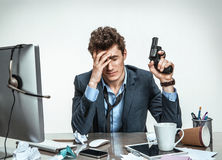 Businessman with gun wants to commit suicide Stock Photo