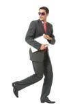 Businessman or hacker running Stock Image