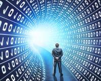 Businessman in hacker world. Businessman standing back in digital tunnel Stock Image