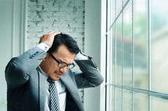 Businessman haedache and heart failure. When he work hards at his offiice stock photography