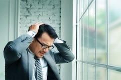 Businessman haedache and heart failure Stock Photography