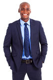 Businessman half length. Handsome african businessman half length portrait royalty free stock images