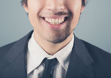 Businessman with half shaved beard Stock Images