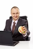 The businessman with a hamburger Stock Photo