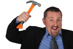 Businessman with a hammer Royalty Free Stock Photo