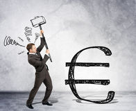 Businessman with hammer and euro sign Royalty Free Stock Photography