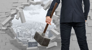 Businessman with hammer in hands Royalty Free Stock Photos